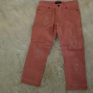 Pink destroyed jean capris